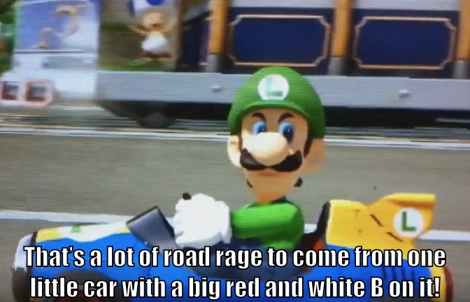 "Luigi giving the death stare: ""That's a lot of road rage to come from one little car with a big red and white B on it!"""