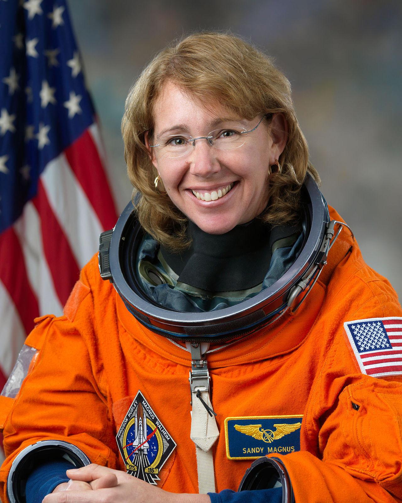 Astronaut Sandra Magnus in spacesuit - public domain photo
